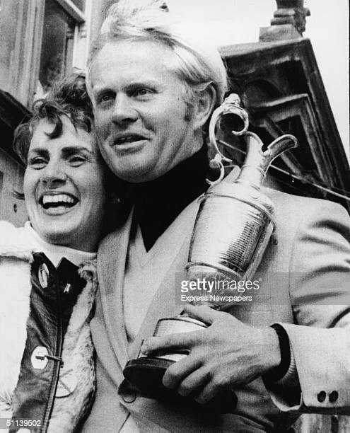 Jack Nicklaus and his wife Barbara pose with Nicklaus's trophy for winning the British Open golf championship on the St Andrews course St Andrews...