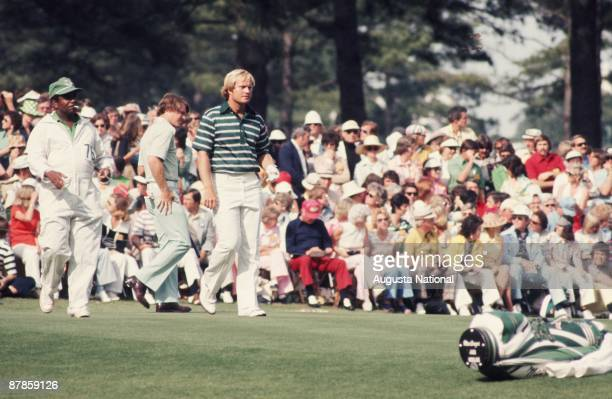 Jack Nicklaus and Tom Watson walk to the green in front of a small gallery during the 1975 Masters Tournament at Augusta National Golf Club on April...