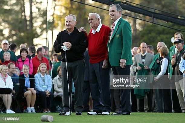 Jack Nicklaus Arnold Palmer and William Porter Payne the chairman of Augusta National Golf Club pose on the first tee prior to starting the first...
