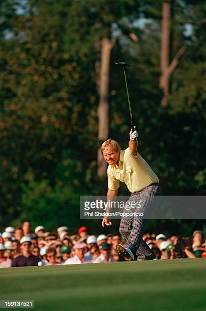 Jack Nicklaus celebrates making a birdie putt at the 17th hole during the final round on his way to winning the US Masters tournament at the Augusta...