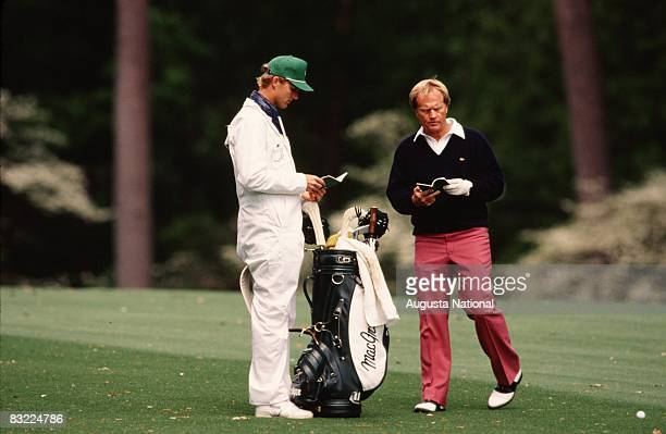 Jack Nicklaus checks his yardage with his son and caddie Jackie during the 1989 Masters Tournament at Augusta National Golf Club in April 1989 in...