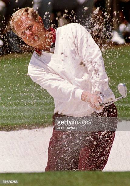 Jack Nicklaus chips out of a sand trap on the second green 10 April 1993 during third round play at the Masters Tournament Georgia Nicklaus fell from...