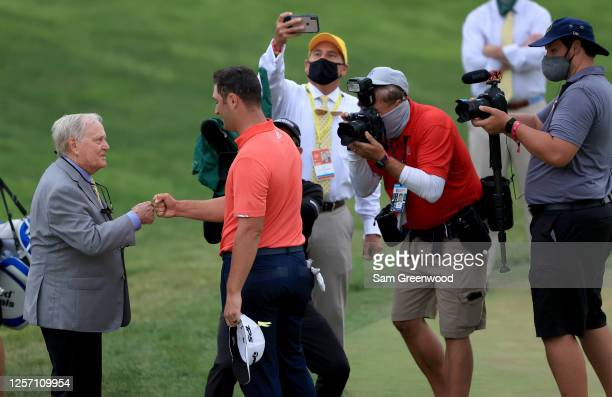 Jack Nicklaus congratulates Jon Rahm of Spain on the 18th green after Rahm won during the final round of The Memorial Tournament on July 19, 2020 at...