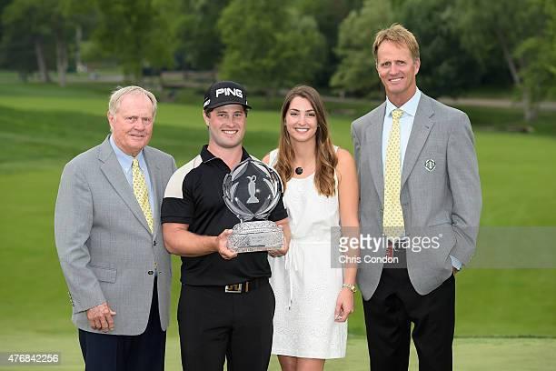 Jack Nicklaus, David Lingmerth, Megan Lingmerth and Jack Nicklaus II pose with the tournament trophy after Lingmerth wins the Memorial Tournament...