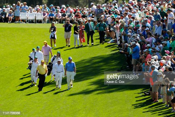 Jack Nicklaus Gary Player and Tom Watson walk together during the Par 3 Contest prior to the Masters at Augusta National Golf Club on April 10 2019...