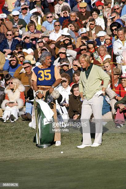 Jack Nicklaus goes over the situation with his caddie during a golf tournament circa 1970's