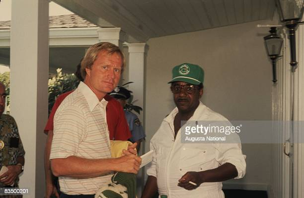 Jack Nicklaus greets a caddie at the Clubhouse during the 1978 Masters Tournament at Augusta National Golf Club in April 1978 in Augusta, Georgia.