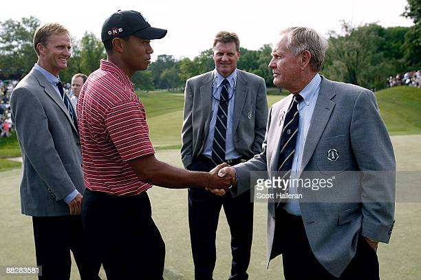 Jack Nicklaus greets Tiger Woods after his onestroke victory alongside his sons Jack Jr and Steve at the Memorial Tournament at the Muirfield Village...