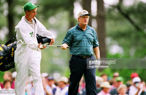 Jack Nicklaus hands his club to his caddie and son Jackie during the 1997 Masters Tournament at Augusta National Golf Club in April in Augusta Georgia