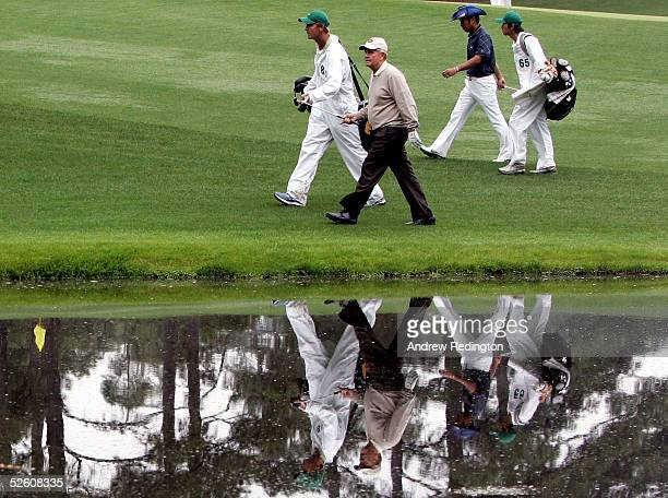 Jack Nicklaus his caddie Jack Nicklaus Jr Shingo Katayama of Japan and his caddie Eka Ishll walk the 16th hole during round two of The Masters at the...