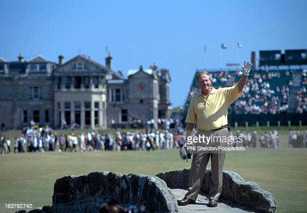 Jack Nicklaus of the United States acknowledges the crowd from the Swilcan Bridge at the British Open Golf Championship held at the St Andrews Golf...
