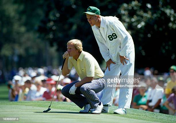 Jack Nicklaus of the United States and his caddieson Jackie line up a putt during the US Masters Golf Tournament held at the Augusta National Golf...
