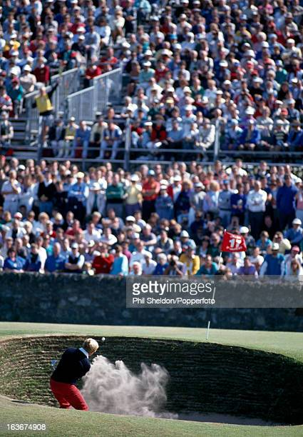 Jack Nicklaus of the United States blasts out of a bunker at the 17th hole also known as the road hole during the British Open Golf Championship held...
