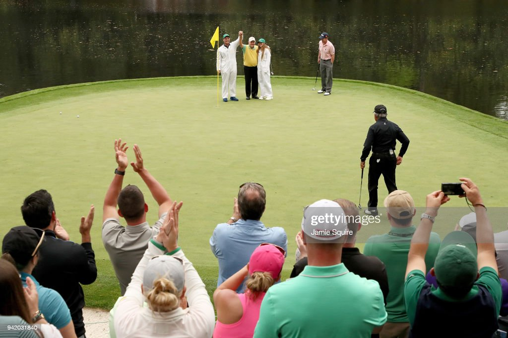Jack Nicklaus of the United States celebrates with his caddie and grandson Gary Nicklaus Jr. and his granddaughter on the ninth green after Gary hit a hole-in-one during the Par 3 Contest prior to the start of the 2018 Masters Tournament at Augusta National Golf Club on April 4, 2018 in Augusta, Georgia.