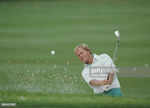 Jack Nicklaus of the United States chips out of the sand bunker on 7 April 1988 during the US Masters Golf Tournament at the Augusta National Golf...