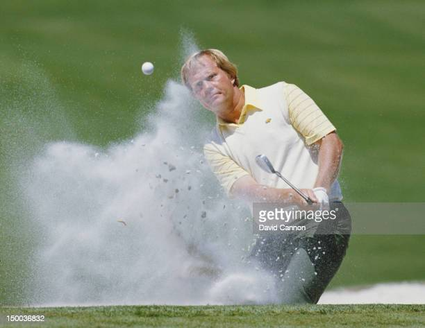 Jack Nicklaus of the United States chips out of the sand bunker on 10th April 1986 during the US Masters Golf Tournament at the Augusta National Golf...