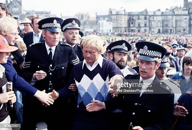 Jack Nicklaus of the United States escorted by policemen after winning the British Open Golf Championship held at the St Andrews Golf Club near...