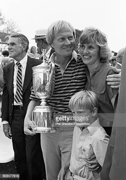 Jack Nicklaus of the United States holding the trophy with his wife Barbara and son Michael after winning the US Open Golf Championship held at the...