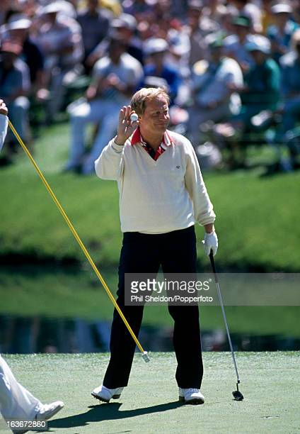 Jack Nicklaus of the United States makes his putt during the US Masters Golf Tournament held at the Augusta National Golf Club in Georgia circa April...