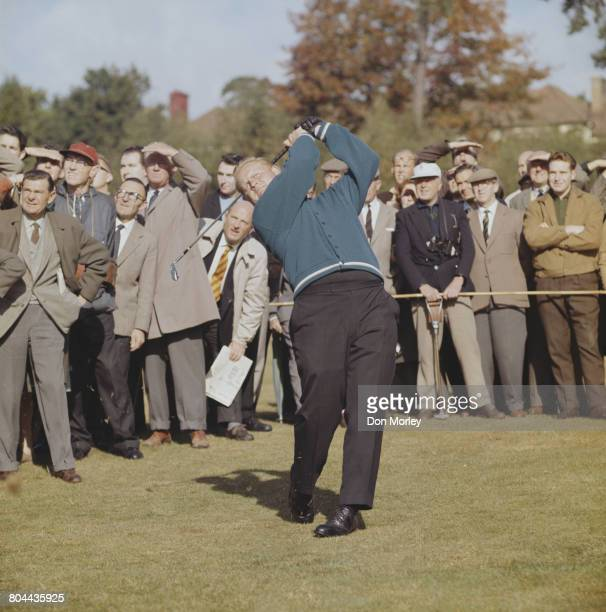 Jack Nicklaus of the United States plays an iron shot as spectators look on during the Piccadilly World Match Play Championship held on 8 October...