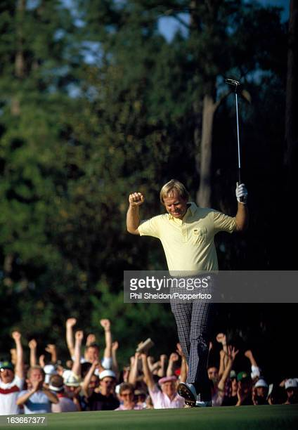 Jack Nicklaus of the United States sinks a birdie putt at the 17th hole during the US Masters Golf Tournament held at the Augusta National Golf Club...