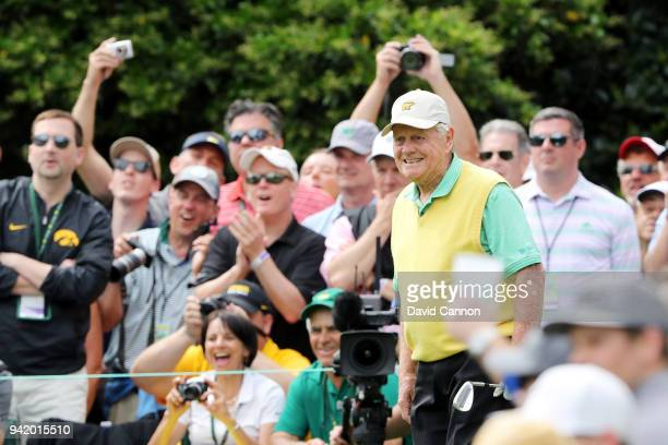 Jack Nicklaus of the United States smiles on a tee as patrons cheer during the Par 3 Contest prior to the start of the 2018 Masters Tournament at...