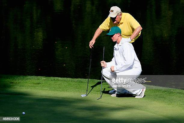 Jack Nicklaus of the United States waits with his caddie during the Par 3 Contest prior to the start of the 2015 Masters Tournament at Augusta...