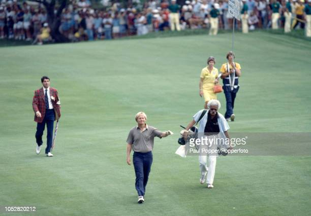 Jack Nicklaus of the United States walks down the fairway with his caddy Angelo Argea on the final day enroute to winning the US PGA Championship at...