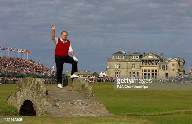 Jack Nicklaus of the United States waves on the Swilcan Bridge during The 134th Open Championship held on the Old Course at St Andrews, from July...
