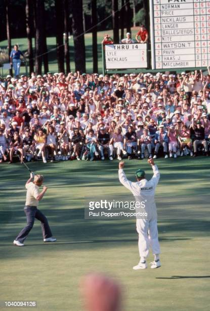 Jack Nicklaus of the United States with his caddy and son Jack Junior celebrates his eagle on the 15th hole during the final round of the US Masters...