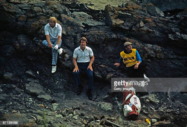 Jack Nicklaus of the USA and Tom Watson of the USA shelter from a storm on the final day of the British Open held at Turnberry Golf Club on July 9...
