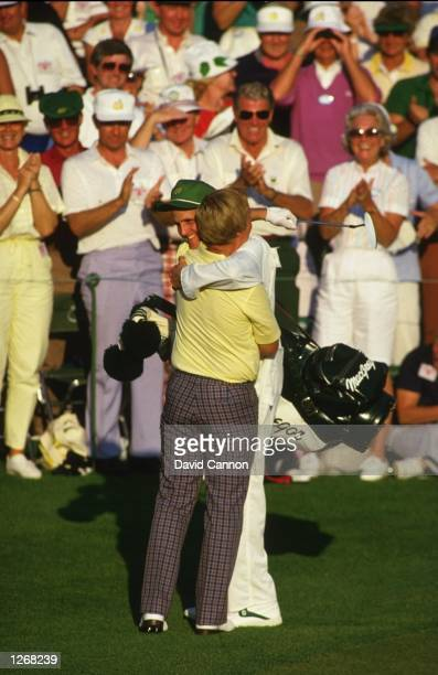 Jack Nicklaus of the USA embraces his son and caddy Jack Jnr on the final day of the US Masters at the Augusta National Golf Club in Georgia USA...