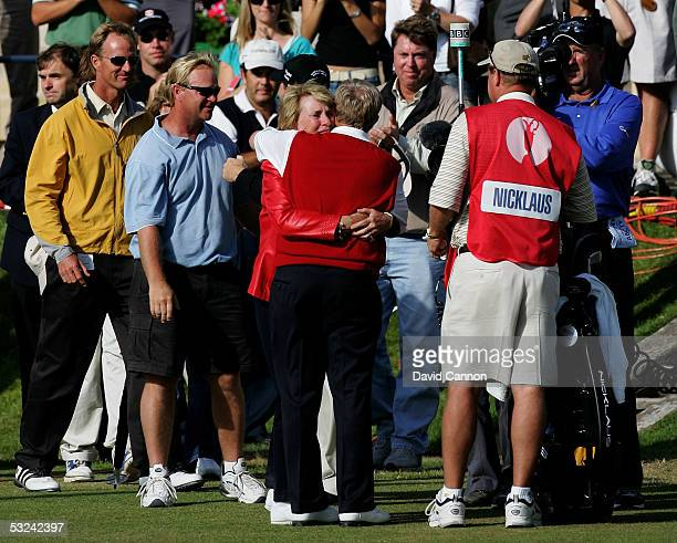 Jack Nicklaus of the USA embraces his wife Barbara at the completion of his round at what could be his last British Open during the second round of...