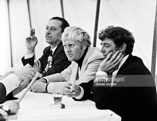 Jack Nicklaus of the USA is flanked by Doug Sanders of the USA and George Simms the Open Championship press officer after Sanders had missed a three...