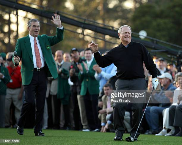 Jack Nicklaus of the USA is watched by William Porter Payne the chairman of Augusta National Golf Club after starting the first round of the 2011...