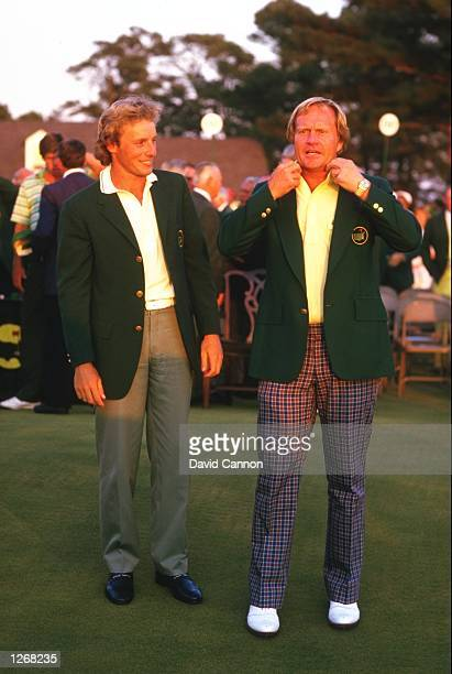 Jack Nicklaus of the USA receives his green jacket from Bernhard Langer of Germany after the United States Masters at the Augusta National Golf Club...