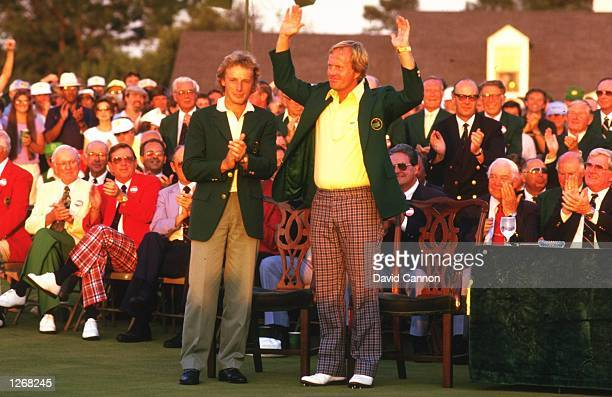 Jack Nicklaus of the USA receives the green jacket from Bernhard Langer of Germany after the US Masters at the Augusta National Golf Club in Georgia...