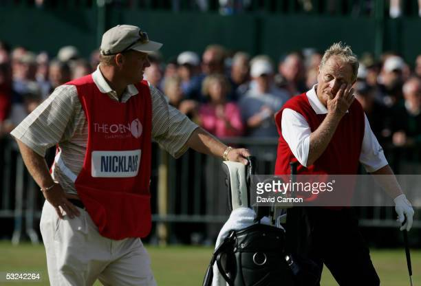 Jack Nicklaus of the USA wipes away a tear on the 18th green as his son and caddy Steve Nicklaus looks on at what could be his last British Open...