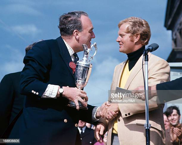 Jack Nicklaus of USA receives the Claret Jug from the Rt Hon Willie Whitelaw the Captain of the Royal and Ancient Golf Club after his playoff victory...
