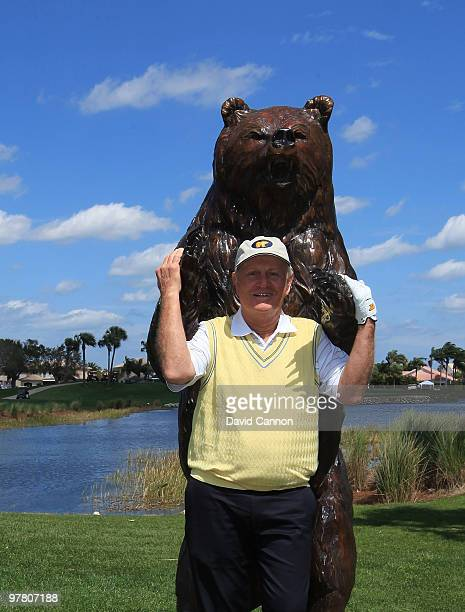 Jack Nicklaus poses with the bear on the 15th tee that signifies the final four holes known as the 'Bear Trap' on the Champion Course that he...
