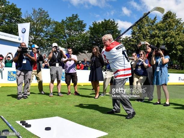 Jack Nicklaus prepares to shoot a puck during the opening ceremonies and hall of fame induction of the RBC Canadian Open at Glen Abbey Golf Course on...