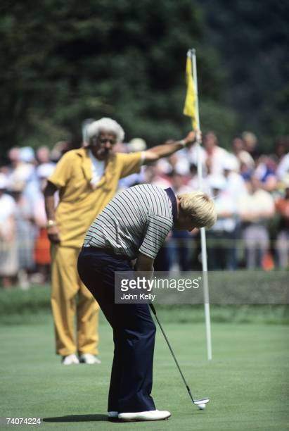Jack Nicklaus putts toward his caddy Angelo Argea during the 1980 US Open at the Baltusrol Golf Club