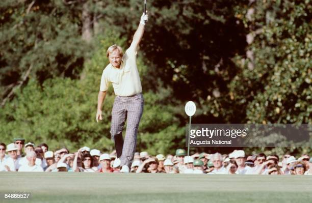 Jack Nicklaus raises his arm in victory after sinking his putt during the 1986 Masters Tournament at Augusta National Golf Club in April 1986 in...