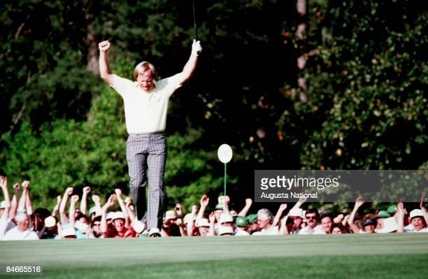 Jack Nicklaus raises his arms in victory after sinking his putt during the 1986 Masters Tournament at Augusta National Golf Club in April 1986 in...