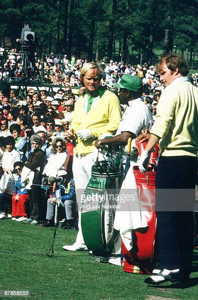 Jack Nicklaus talks with his caddie in front of a large gallery during the 1973 Masters Tournament at Augusta National Golf Club on April 1973 in...
