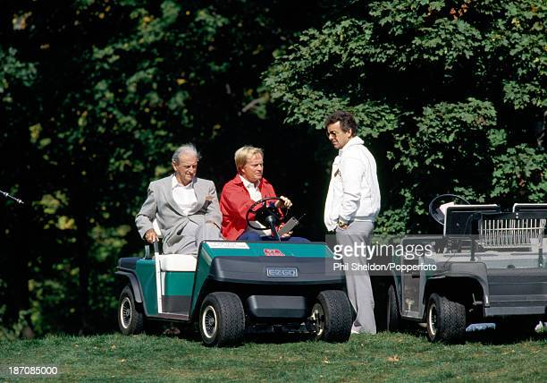 Jack Nicklaus the nonplaying captain of the United States team and Tony Jacklin the nonplaying captain of the European team with Nicklaus' coach Jack...