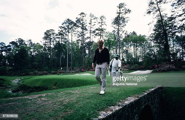 Jack Nicklaus walks off the 13th green with his caddie during the 1973 Masters Tournament at Augusta National Golf Club on April 1973 in Augusta...