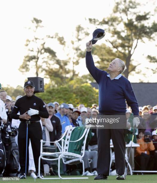 Jack Nicklaus waves his cap to the sky to commemorate late Arnold Palmer before taking his honorary first tee shot for the start of the Masters golf...