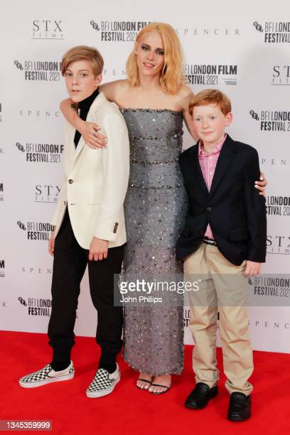 """Jack Nielen, Kristen Stewart and Freddie Spry attend the """"Spencer"""" UK Premiere during the 65th BFI London Film Festival at The Royal Festival Hall on..."""