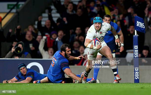 Jack Nowell of England beats Yoann Maestri of France to score England's fifth try during the RBS Six Nations match between England and France at...